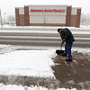 Ray Barber shovels the sidewalk at the 1400 block of Main Street in Longmont on Wednesday.<br /> Cliff Grassmick / October 29, 2009