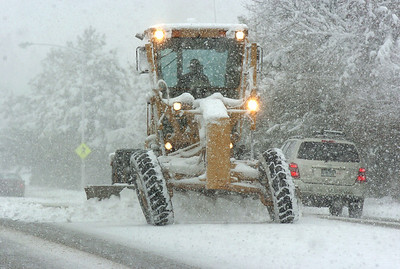 A City and County of Broomfield road grader plows 136th Avenue near Main Street during the winter storm on Wednesday  October 28, 2009 Staff photo/David R. Jennings
