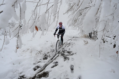 SNOW15.JPG SNOW15 Aaron Bouplon of Boulder rides his bike near the North Foothills Trailhead off Lee Hill Road on Wednesday morning. Photo by Marty Caivano/Camera/Oct. 28, 2009