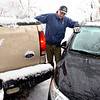 Tom Fraser looks at the distance between two cars as he tried to help a friend whose car was stuck on University Hill in Boulder. The group went to get another car to tow the truck out.<br /> Photo by Paul Aiken / The Camera / Oct 28, 2009