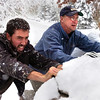 SNOW2.JPG From left to right Chris Norman, Tom Fraser, and Don Snyder help push out a friend  whose car was stuck on University Hill in Boulder.<br /> Photo by Paul Aiken / The Camera / Oct 28, 2009