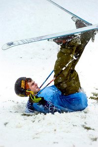 Andrew Linenfelser takes a hard fall after he made a jump off a homemade ramp in North Boulder Park on Wednesday morning. Photo by Paul Aiken / The Camera / Oct 28, 2009