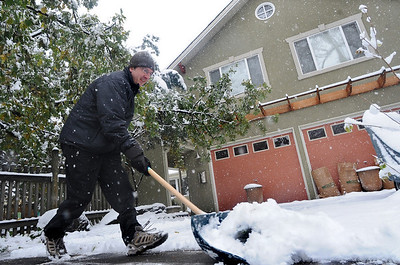 SNOW16.JPG SNOW16 Tom Bagli shovels his driveway in north Boulder on Wednesday. Photo by Marty Caivano/Camera/Oct. 28, 2009