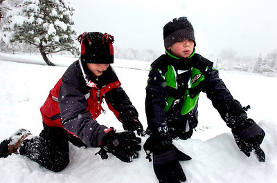 Graham Blanco, left and Colton Brandt, both 10, work on building a snow fort in North Boulder Park in Boulder on Wednesday morning. Photo by Paul Aiken / The Camera / Oct 28, 2009