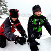 Graham Blanco, left and Colton Brandt, both 10, work on building a snow fort in North Boulder Park in Boulder on Wednesday morning.<br /> Photo by Paul Aiken / The Camera / Oct 28, 2009