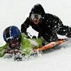 Jayden Henkel, left, and brother Cameron, enjoy the snow at Scott Carpenter Park on a snowy Wednesday.<br /> Cliff Grassmick / October 29, 2009