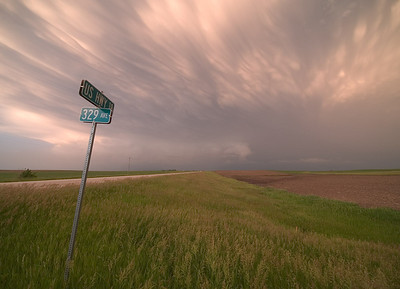 One of the best mammatus shows I have ever seen from storm chase trip 2007. Love the leaning sign. Olympus E3, 7-14mm