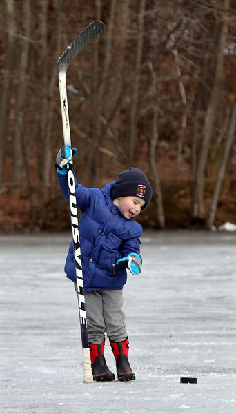 Ice skating at the pond at Roberts Field in Chelmsford. Jake LaBrecque, 3, of Chelmsford, tries to handle a full size hockey stick. (SUN/Julia Malakie)