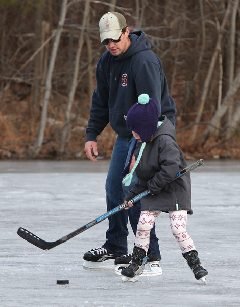 Ice skating at the pond at Roberts Field in Chelmsford. Kenny LaBrecque of Chelmsford skates with his daughter Annika LaBrecque, 6, who is starting a girls hockey program this year. (SUN/Julia Malakie)