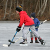 Ice skating at the pond at Roberts Field in Chelmsford. Jake LaBrecque, 3, of Chelmsford, rear, watches Liam Dowd, 10, of Chelmsford, skate by. Jake's mom said he was quite interested in watching the bigger kids skate. (SUN/Julia Malakie)