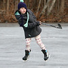 Ice skating at the pond at Roberts Field in Chelmsford. Annika LaBrecque, 6, of Chelmsford, who is starting a girls hockey program this year, gets some practice. (SUN/Julia Malakie)