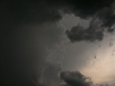 Thanks for the comments on my pics of my daughter.  She is my most photographed subject!  Hope you like this pic of the sky.  It was a strong storm that just passed over me at work and was on its way to my home at the same time I was.
