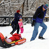 "Bob Carlin, pulls up his daughter Francesca, 2, for another run down the hill.<br /> It was another big sledding day at Scott Carpenter Park on Sunday.<br /> For more sledding photos, go to  <a href=""http://www.dailycamera.com"">http://www.dailycamera.com</a>.<br /> Cliff Grassmick / November 15, 2009"