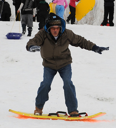 "It is surfs up for Jerry Greene on Sunday.<br /> It was another big sledding day at Scott Carpenter Park on Sunday.<br /> For more sledding photos, go to  <a href=""http://www.dailycamera.com"">http://www.dailycamera.com</a>.<br /> Cliff Grassmick / November 15, 2009"