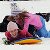 """Ciara Donovan, bottom, and Olivia Pfeiffer, double up on the sled at Scott Carpenter Park.<br /> It was another big sledding day at Scott Carpenter Park on Sunday.<br /> For more sledding photos, go to  <a href=""""http://www.dailycamera.com"""">http://www.dailycamera.com</a>.<br /> Cliff Grassmick / November 15, 2009"""