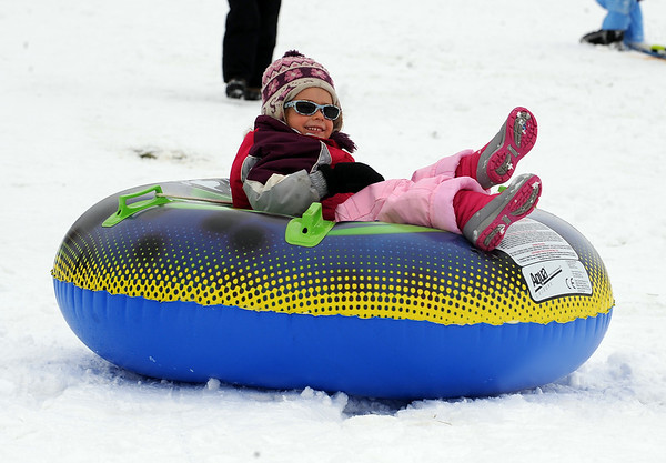 "Ria Yankee, 5, rides the big tube on the hill at Scott Carpenter.<br /> It was another big sledding day at Scott Carpenter Park on Sunday.<br /> For more sledding photos, go to  <a href=""http://www.dailycamera.com"">http://www.dailycamera.com</a>.<br /> Cliff Grassmick / November 15, 2009"