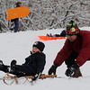 "Saleem Douly gives his son, Christopher, 2, a push during a day of sledding.<br /> It was another big sledding day at Scott Carpenter Park on Sunday.<br /> For more sledding photos, go to  <a href=""http://www.dailycamera.com"">http://www.dailycamera.com</a>.<br /> Cliff Grassmick / November 15, 2009"