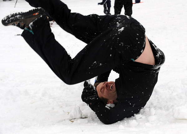 "Grant Besser takes a spill while sledding with the family on Sunday.<br /> It was another big sledding day at Scott Carpenter Park on Sunday.<br /> For more sledding photos, go to  <a href=""http://www.dailycamera.com"">http://www.dailycamera.com</a>.<br /> Cliff Grassmick / November 15, 2009"