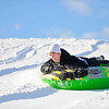 Tyler Wade, 18, of Leominster, a freshman at UMass Dartmouth, slides on a tube down a hill off Leominster Rd. in Lunenburg while on school vacation, Wednesday afternoon.<br /> SENTINEL & ENTERPRISE / BRETT CRAWFORD