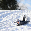 T.J. Landon, 18, of Leominster, a freshman at MWCC, sleds head-first down a hill off Leominster Rd. in Lunenburg while on school vacation, Wednesday afternoon.<br /> SENTINEL & ENTERPRISE / BRETT CRAWFORD