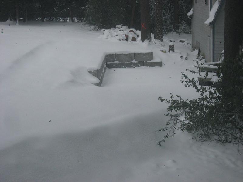 A gratuitous snow bank shot looking towards the garage.