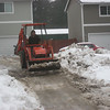 John removing snow from his driveway.