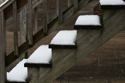 Snow on the stairs.