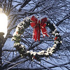 Wreath on Merrimack Street during first snow of the season in downtown Lowell. (SUN/Julia Malakie)