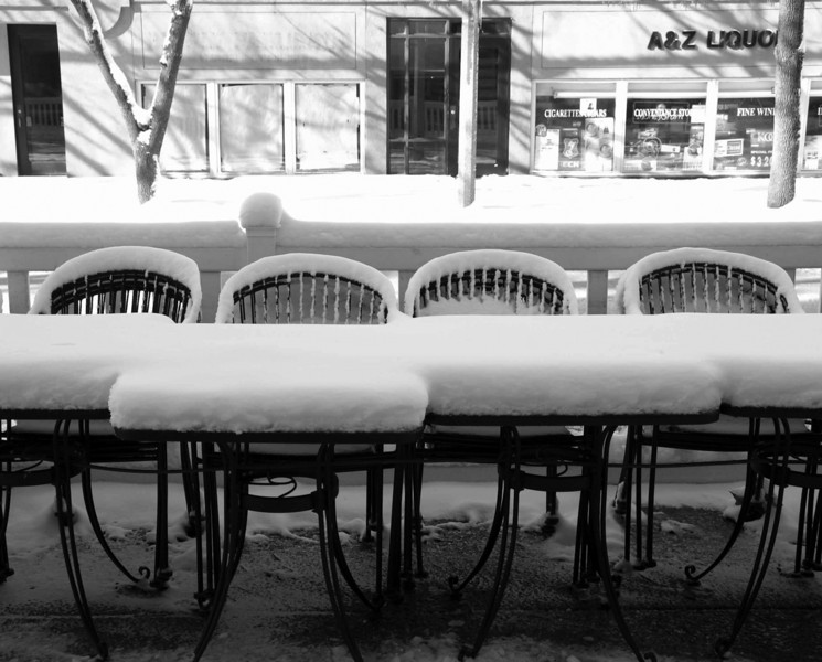 Cafe tables are covered with snow, which looks like a big piece of tofu.<br /> photo by RL
