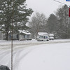 Mail carrier pulled out of a snow drift