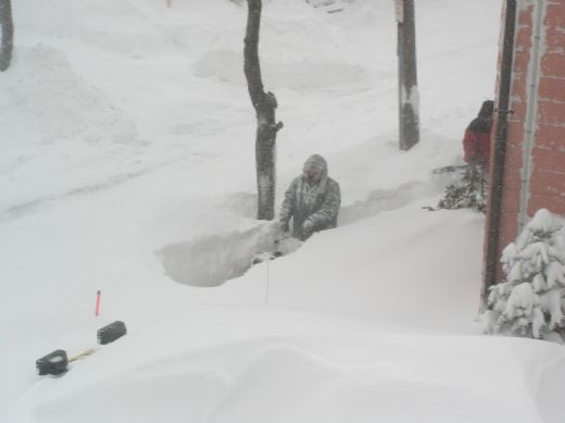 Digging out a path in deep snow. <br/> (c) R.W. Hallett