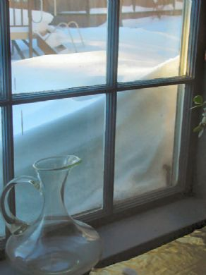 Snow up to the window. <br/> (c) Ted Larsen