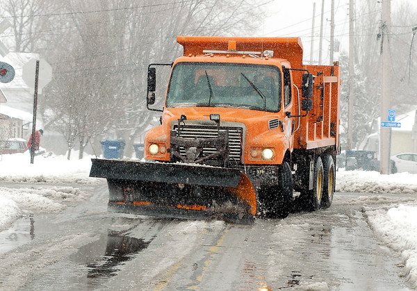 A Anderson city snowplow starts to work down west Vineyard Street.