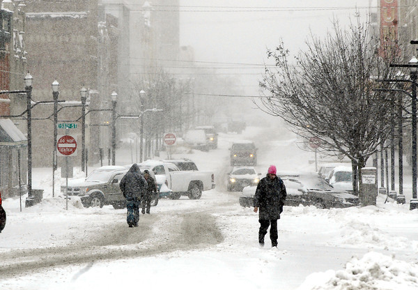 A early spring storm dumped as much as 10 inches of heavy, wet snow over the area.  Monday morning these folks found it easier to walk down the middle of Meridian Street through downtown then the sidewalks.