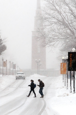 A early spring storm dumped as much as 10 inches of heavy, wet snow over the area Sunday night and Monday morning.  These AU students made their way through the snow to get to class.