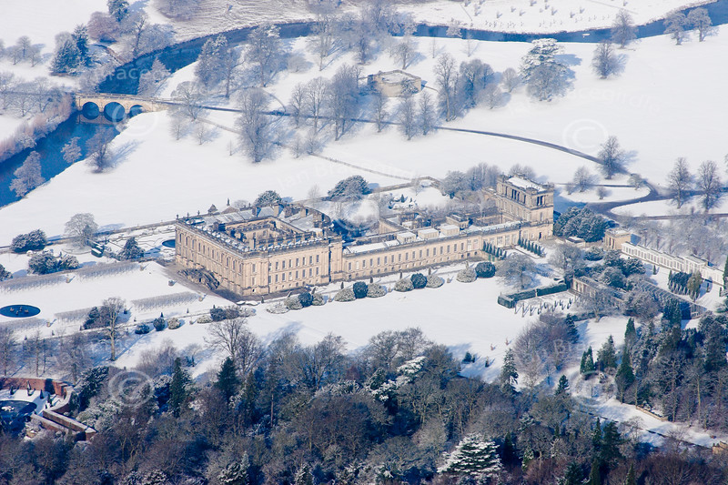 Chatsworth House in the snow from the air.