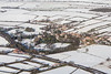 An aerial photo of Caunton village in Nottinghamshire in the snow.