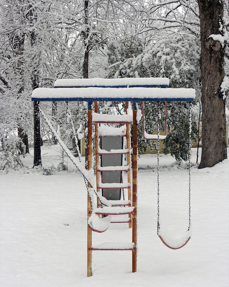 Feb 12.  The swing set seat full of snow.