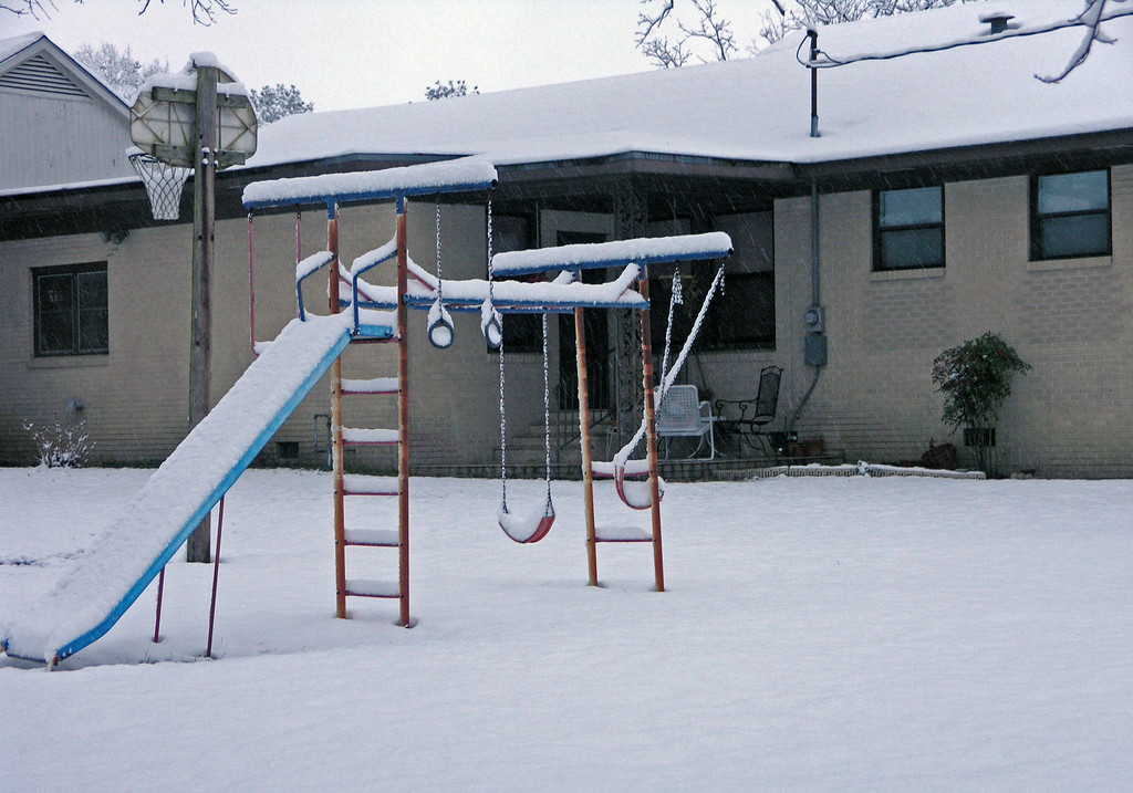 Feb 12.  The old swing set and the basketball goal.  The goal is full of snow.