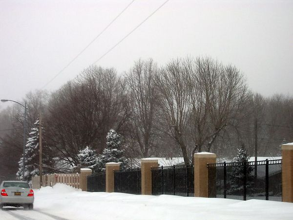 "<br><br><font size=""3"">Snow piled up on the side of the street.</font>"