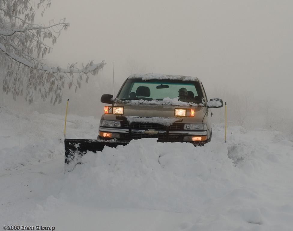 Anne plows the road.