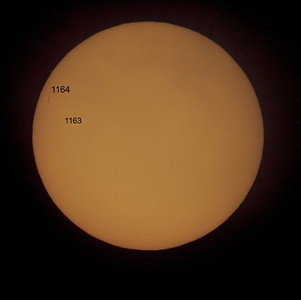Feb 27 2011. Photo of the sun captured with Olympus E5, 90-250mm lens with x2 teleconverter (EC-20). Lens fitted with solar filter (hand made using Baader film). Sunspot 1164 just popping up on the NW horizon. Sunspot 1163 is barely visible yet very active, already producing M class flares.