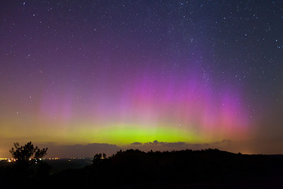 This aurora display following an X-class flare's arrive at earth was nothing short of incredible.  It was by far the brightest, most vivid, and most colorful display I've ever seen, and this was shot in western Iowa.  While it only went in spurts, the lights were so easily visible and so colorful that it tops any other display I've seen.