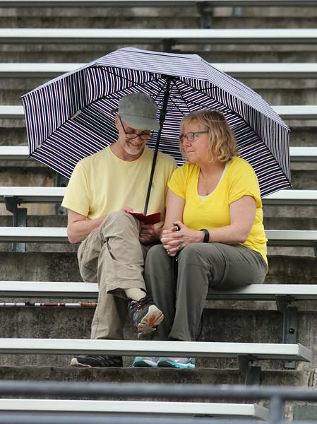 Spectators in rain 072316