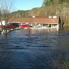 Sandbagging to ease flooding of retail parking lot along Woodruff St