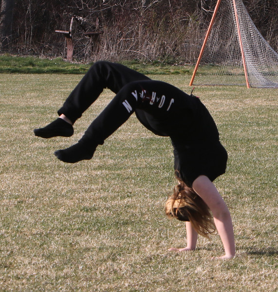 Features at Veterans Memorial Park in Dracut.  Lillie Brown, 12, of Lowell, does handsprings while playing volleyball. JULIA MALAKIE/LOWELLSUN