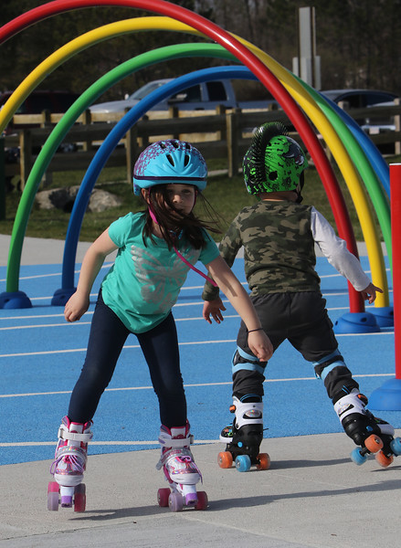 Features at Veterans Memorial Park in Dracut. Olivia Keyes, 6, and her brother Owen Keyes, 4, of Dracut, go roller skating on the slightly softer surface of the water park. JULIA MALAKIE/LOWELLSUN