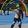 Features at Veterans Memorial Park in Dracut. Owen Keyes, 4, and his sister Olivia, 6, of Dracut, go roller skating on the slightly softer surface of the water park. JULIA MALAKIE/LOWELLSUN