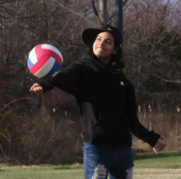 Features at Veterans Memorial Park in Dracut.  Zaily Pacheco, 15, of Lowell, tries playing volleyball. JULIA MALAKIE/LOWELLSUN