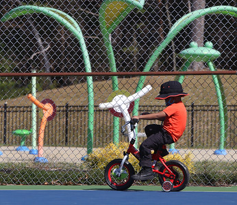 Spring weather features in Leominster. Kahmari Joseph, 4, of Clinton, practices riding his bike with training wheels at Fournier Park in Leominster.  JULIA MALAKIE/LOWELLSUN
